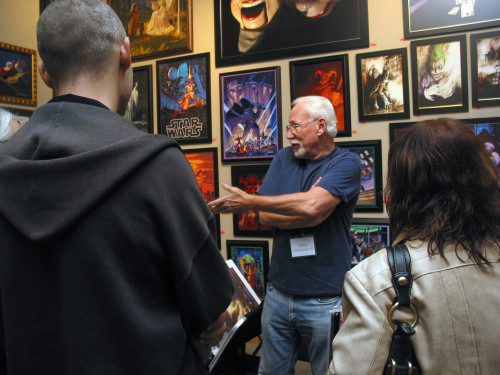 Greg Hildebrandt gestures to a small crowd at his booth during IX8 in Allentown, Pa.